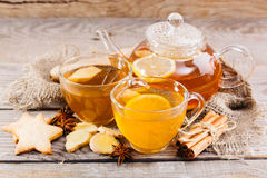 Cup of hot tea and a teapot. ginger, cinnamon, anise, cookies Royalty Free Stock Photography