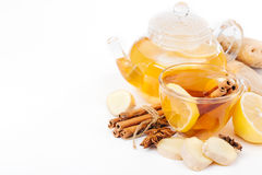 Cup of hot tea and a teapot. ginger, cinnamon, anise, lemon Royalty Free Stock Photos