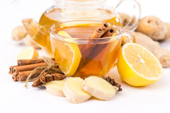 Cup of hot tea and a teapot. ginger, cinnamon, anise, lemon Royalty Free Stock Images