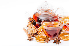 Cup of hot tea and a teapot. ginger, cinnamon, anise, lemon Stock Image