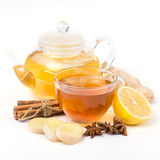 Cup of hot tea and a teapot. ginger, cinnamon, anise, lemon Stock Photos