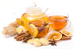 Cup of hot tea and a teapot. ginger, cinnamon, anise, lemon Royalty Free Stock Photo