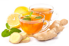 Cup of hot tea and a teapot. ginger, lemon and mint Stock Images