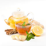 Cup of hot tea and a teapot. ginger, lemon and mint Stock Image