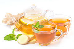 Cup of hot tea and a teapot. ginger, lemon and mint Stock Photography