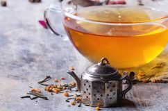 Cup of hot tea with teastrainer Royalty Free Stock Image
