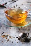 Cup of hot tea with teastrainer Stock Photo