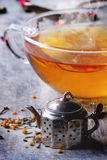 Cup of hot tea with teastrainer stock image