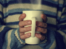 Cup of hot tea  warming in the hands Stock Photo