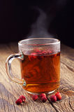 Cup of hot tea with wild strawberries Stock Photos