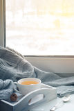 Cup of hot tea on the windowsill Royalty Free Stock Photo