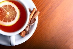 Cup of hot tea on wooden background Royalty Free Stock Image