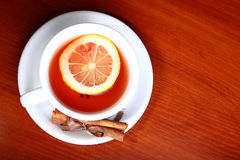 Cup of hot tea on wooden background Royalty Free Stock Photos