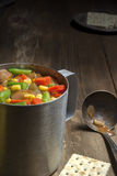 Cup of hot vegetable soup Stock Image