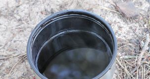 Cup of hot water on the beach in the daytime.  stock video footage
