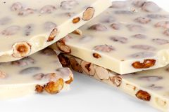White chocolate with nuts stock photography