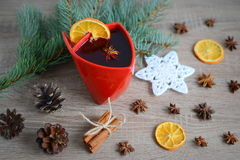 Cup of hot wine with christmas decorations Stock Photos