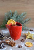 Cup of hot wine with christmas decorations Royalty Free Stock Photos