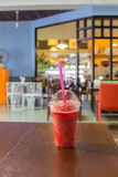 A cup of Ice Juice Strawberry shake. At coffee shop Stock Images