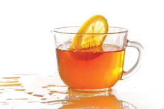 Cup of ice tea and lemon with splash Royalty Free Stock Photos