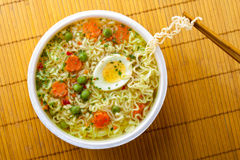 Cup of instant noodles. With vegetables on a traditional mat Royalty Free Stock Photography