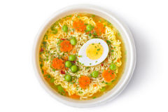 Cup of instant noodles with vegetables. Top view Stock Image