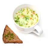 A cup of instant soup and a slice of bread Stock Photos