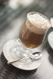 A cup of irish coffee. A cup of coffee on rattan table Stock Photography
