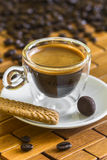 Cup of italian espresso with biscuit and almond in chocolate Stock Images