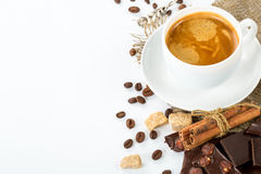 Cup of Italian espresso with cinnamon coffee beans brown sugar. Close up of freshly prepared cup of Italian espresso with cinnamon coffee beans brown sugar Stock Images