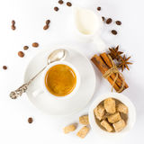 Cup of Italian espresso with cinnamon coffee beans brown sugar. Close up of freshly prepared cup of Italian espresso with cinnamon coffee beans brown sugar Stock Photo