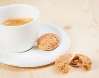 Cup of italian espresso coffee near biscuit Stock Images