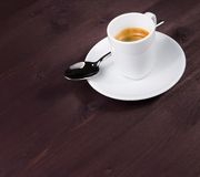 A cup of italian espresso coffee with spoon Stock Images