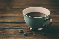 Cup of italian stong coffee espresso on the vintage table. Selective focus Royalty Free Stock Photos