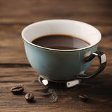 Cup of italian stong coffee espresso on the vintage table. Selective focus and square image Royalty Free Stock Photography