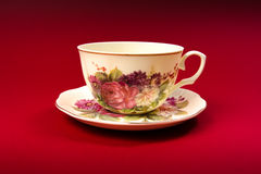 Cup. Ivory cup at red background stock images