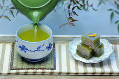 A cup of Japanese green tea and Japanese sweets (yokan). Stock Photos