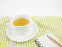 The cup of Japanese green tea and small note book Stock Photography