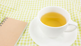 The cup of Japanese green tea and small note book Stock Photo