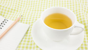 The cup of Japanese green tea and small note book Stock Images