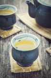 Cup of Japanese green tea with teapot Royalty Free Stock Photos