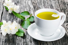 A cup of jasmine tea  with jasmine flowers , close-up Royalty Free Stock Photo