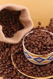 Cup Kaffeebohnen Stockbilder