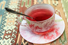 Cup of karkade tea Stock Images
