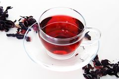 Cup of Karkadeh Red Tea. Glass Cup of Karkadeh Red Tea with Dry Flowers Royalty Free Stock Photo