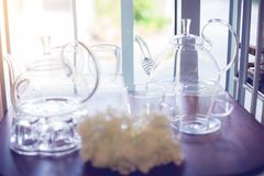 Cup and kettle glass on shelves stock photo