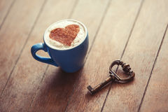 Cup and key. Royalty Free Stock Photography