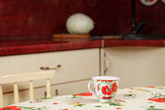 Cup in kitchen Royalty Free Stock Image