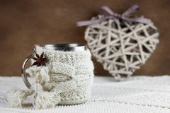 Cup in knitted cover Stock Photos