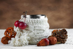 Cup in knitted cover Stock Images